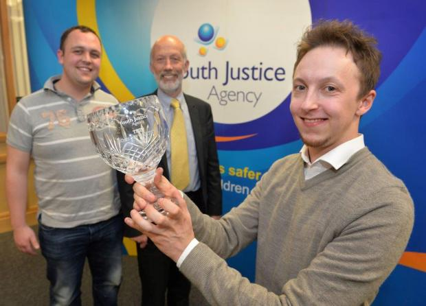 Minister Ford pictured with winner Matthew Carroll and Adam McCartney