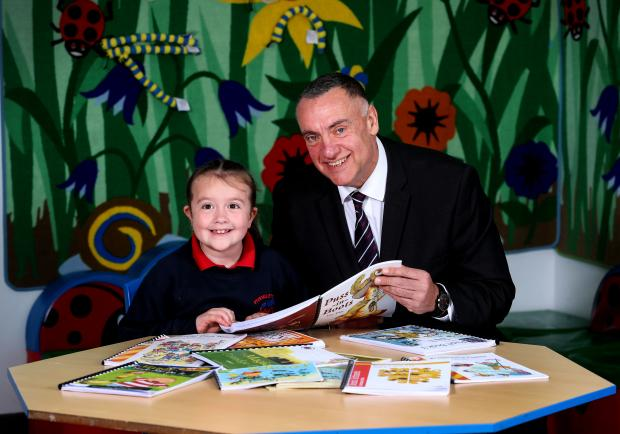 Pictured with the Fivemiletown Primary School pupil is David Kennedy, Governor of Maghaberry Prison.