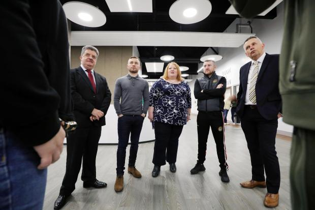 justice minister naomi long pictured with carl frampton and paddy barnes