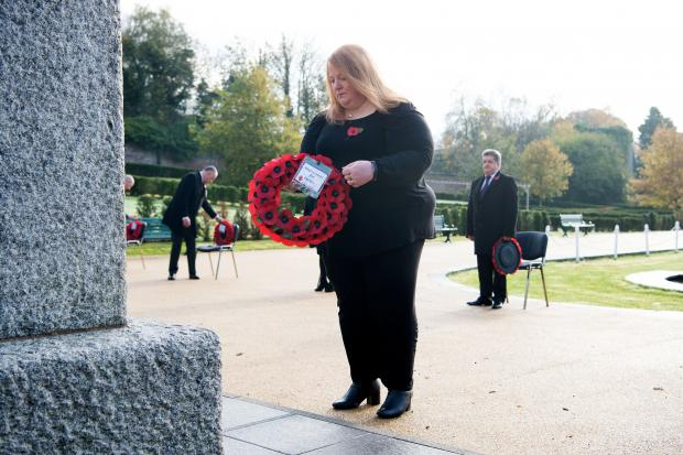 Justice Minister Naomi Long laying a wreath at the Northern Ireland Prison Service (NIPS) Annual Memorial Service to remember officers who lost their lives in the course of duty.