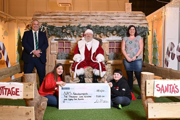 David Savage, Maghaberry Prison Deputy Governor, visited the National Autistic Society Santa's Grotto at Newtownards to present a cheque for £5,185, proceeds of prisoners' recycling and catering fundraising efforts. Included are Jasmine Savage, Trudi Kild