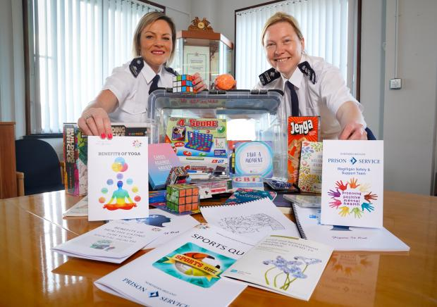Magilligan prison staff Kirsty Brolly and Kirstie McDonald have developed a unique box of puzzles and activities for prisoners showing signs of anxiety, distress and agitation. The HIS Help I'm Struggling Box contains drawing and art activities, rubix c