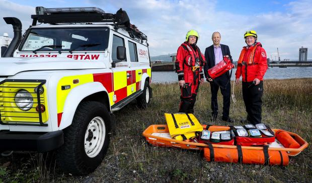 Peter May pictured with NI Search and Rescue members