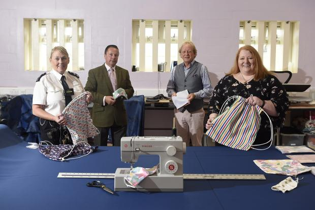 Justice Minister Naomi Long is pictured with Magilligan Prison Governor Richard Taylor, Senior Officer Wendy Graham and Rev David Latimer from Londonderry First Presbyterian Church in the Sewing Bee Hub at Magilligan Prison, where prisoners have been busy