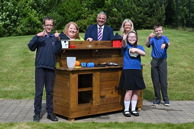 Justice Minister Naomi Long pictured with pupils from TOR school